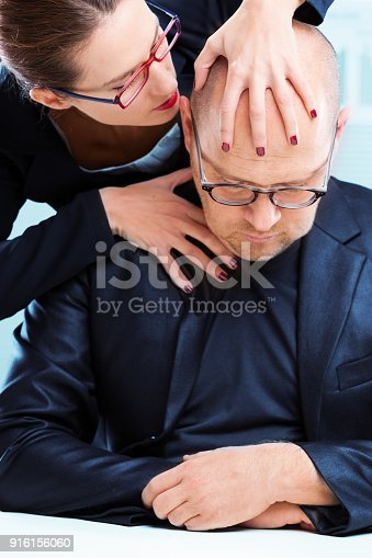 istock woman man at workplace 916156060