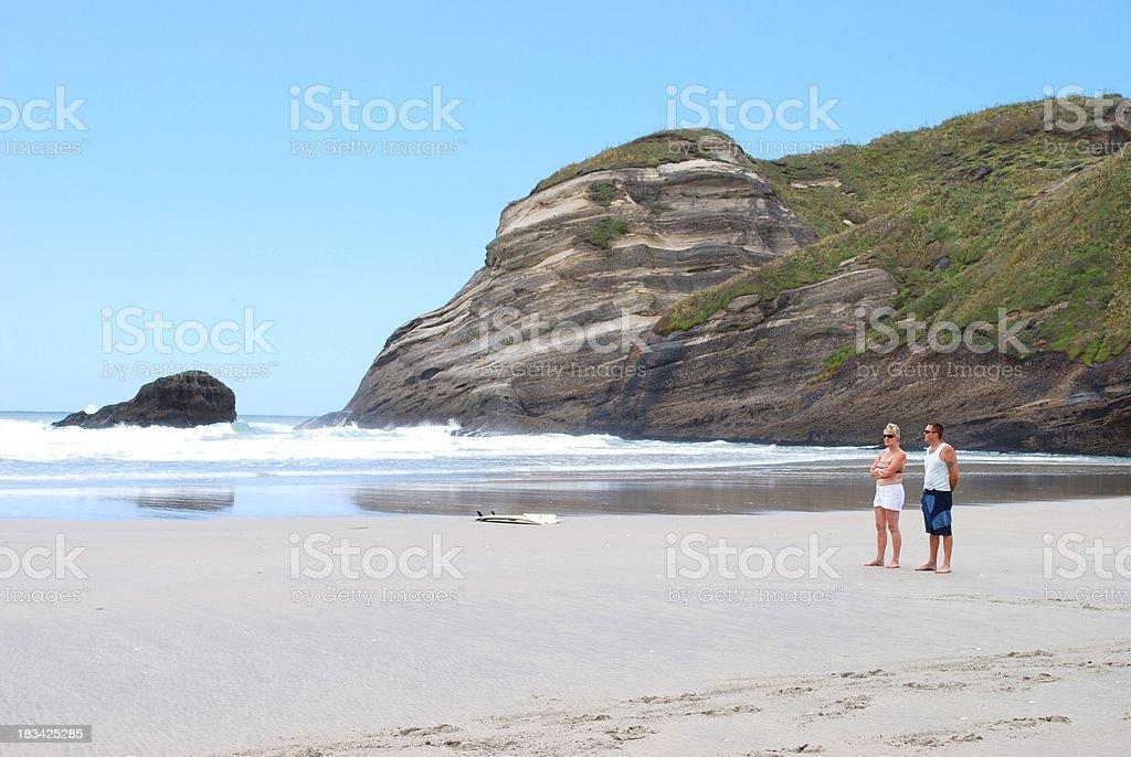 Woman & Man stare to Sea stock photo