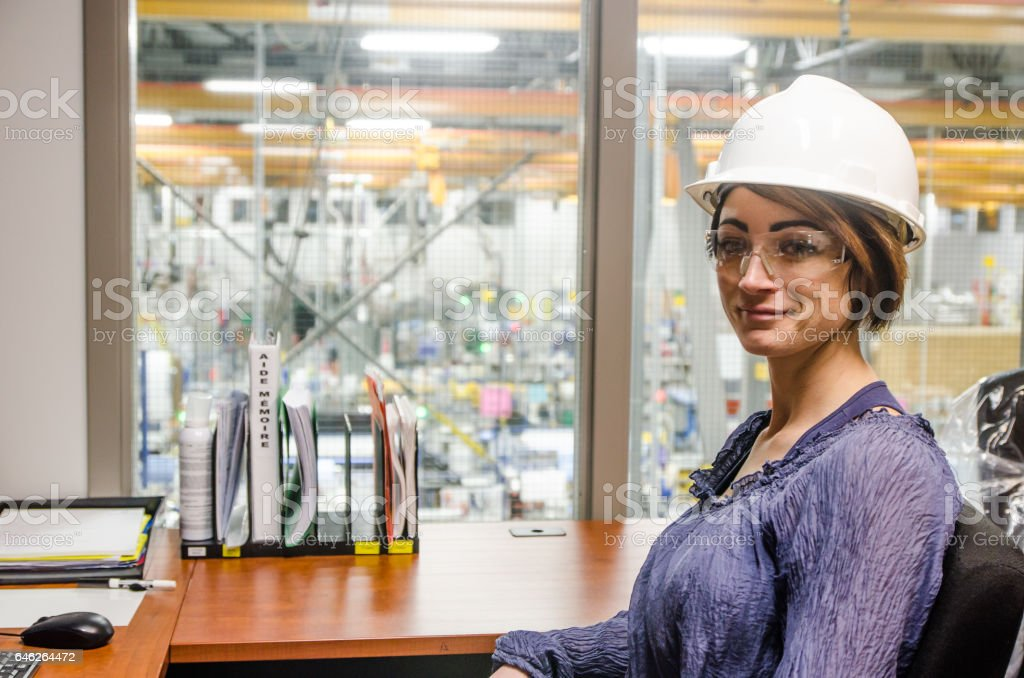 Woman manager in her office with view over her manufacture stock photo
