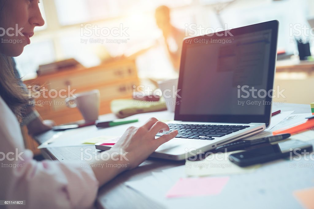 Woman manager working with project on laptop stock photo