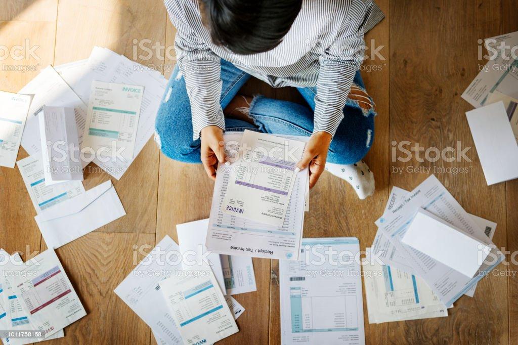 Woman managing the debt stock photo