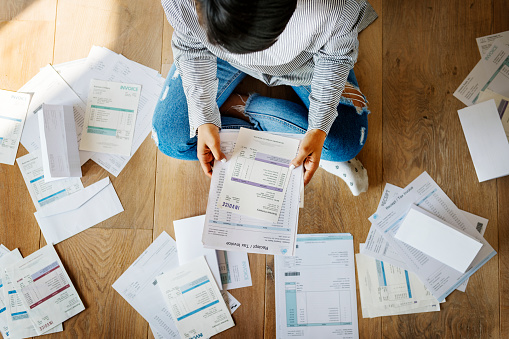 Woman Managing The Debt Stock Photo - Download Image Now