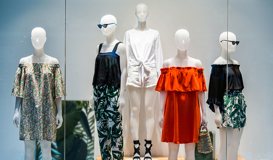 Woman mannequins in store window