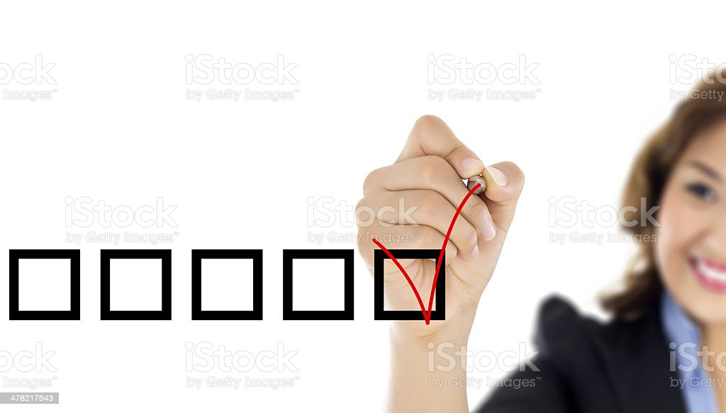Woman Marking in a Checkbox stock photo