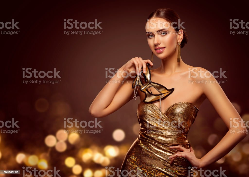 Woman Mask, Fashion Model Face with Golden Carnival Mask, Beauty Gold Dress stock photo