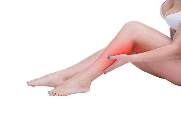 woman, massage of female feet, ache in body isolated - wadenkrämpfe was tun stock-fotos und bilder