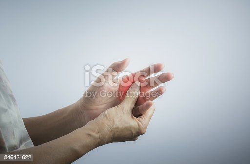 istock Woman massaging her painful hand. Woman holding her hand, pain concept. 846421622
