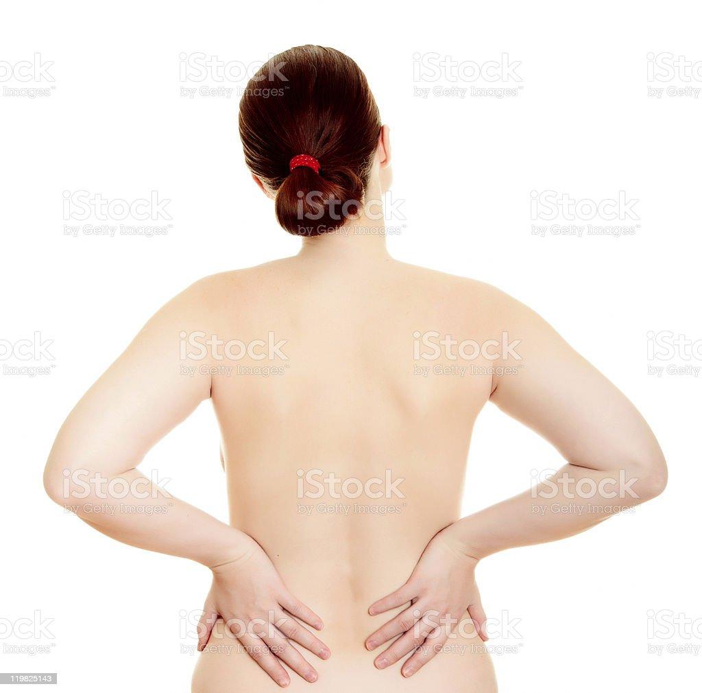Woman massaging pain back royalty-free stock photo