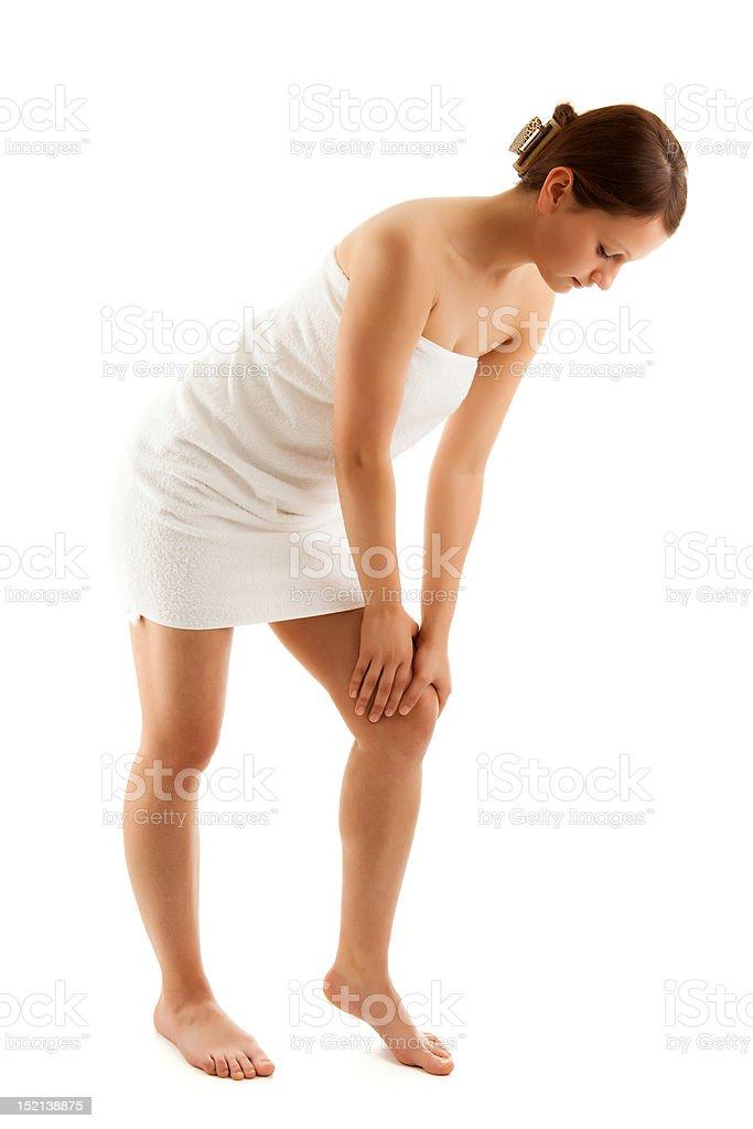 Woman massaging pain leg royalty-free stock photo