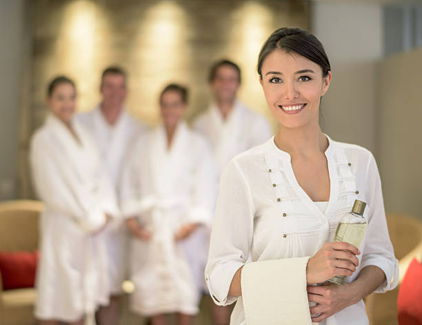 woman masseuse at the spa - beautician stock photos and pictures