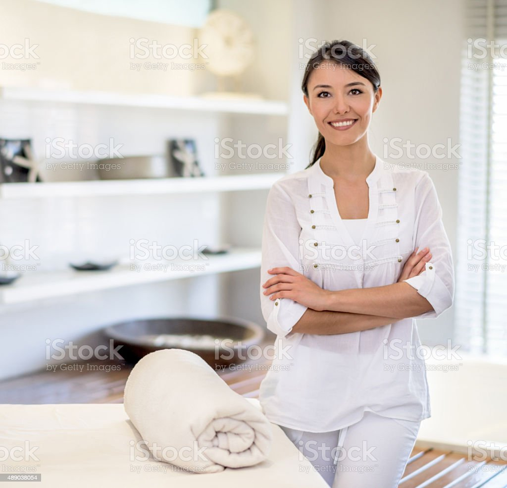 Woman masseuse at the spa stock photo
