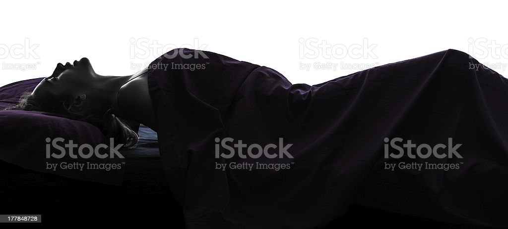 woman masturbating  in bed silhouette stock photo