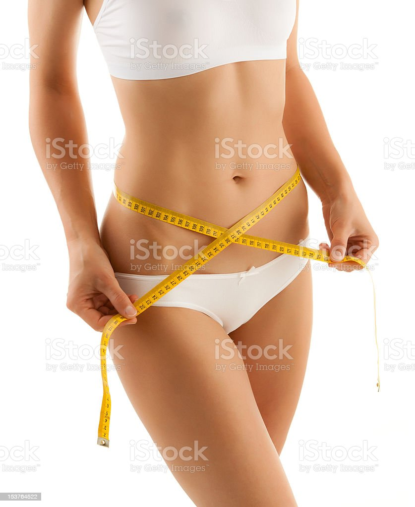 Woman measuring her body isolated on white royalty-free stock photo