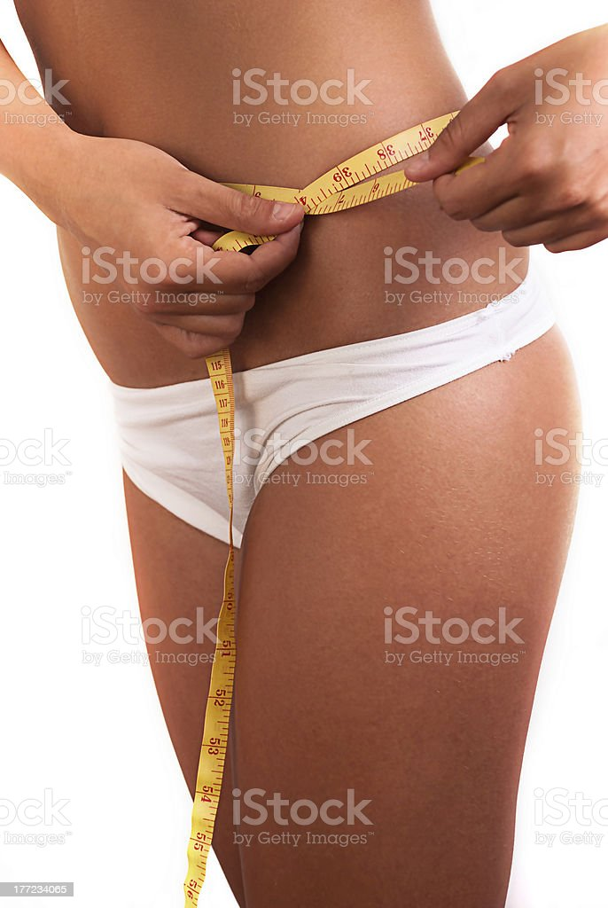 Woman measuring her body. royalty-free stock photo