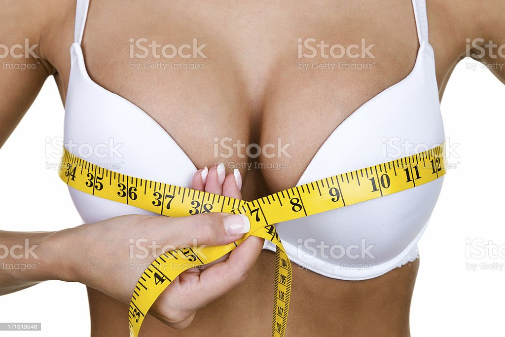 Woman measuring her breast stock photo