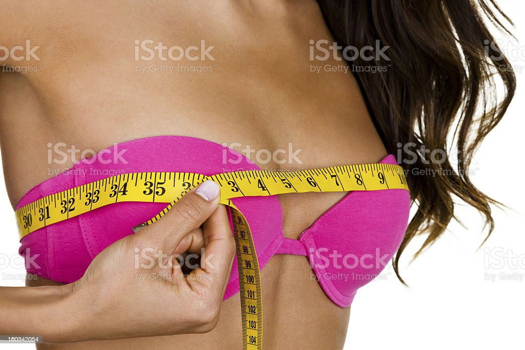 Woman measuring her breast size royalty-free stock photo