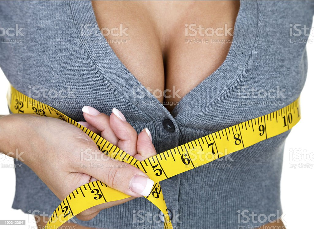 Woman measuring her breast size​​​ foto