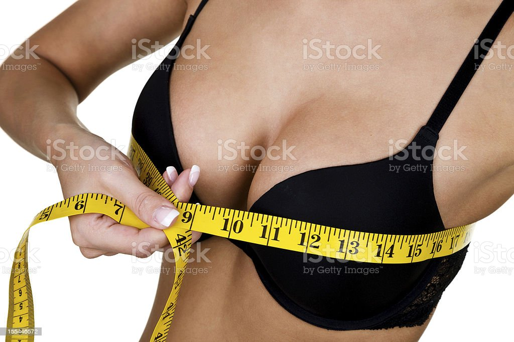 Woman measuring her chest royalty-free stock photo