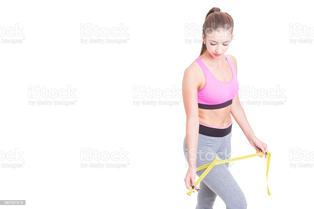 Woman measuring her leg with tape line stock photo