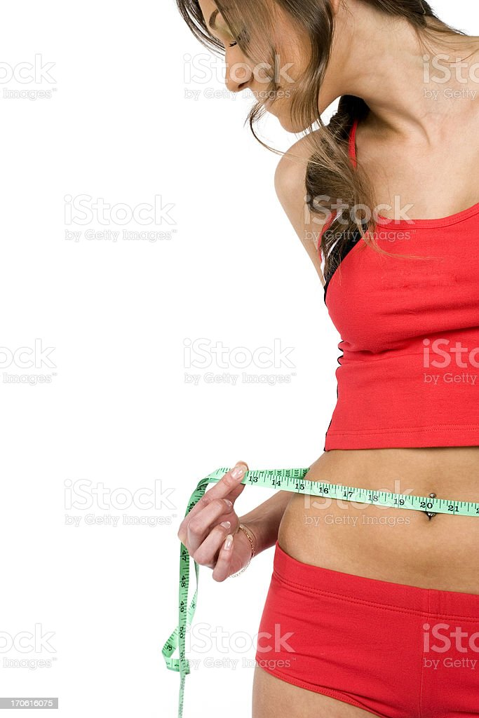 Woman Measuring Waist royalty-free stock photo