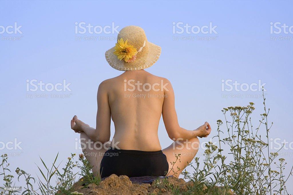 woman meditates on nature stock photo