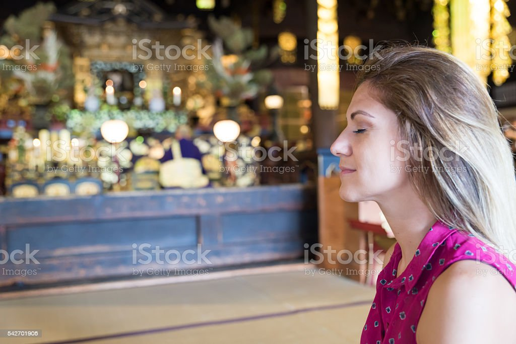 Woman meditating at Kyoto Hyakumanben Chionji Temple stock photo