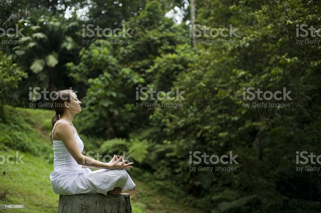 Woman Meditating in Forest royalty-free stock photo