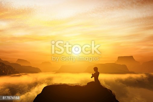 Woman meditating in sitting yoga position on the top of mountains above clouds at sunset. Zen, meditation, peace