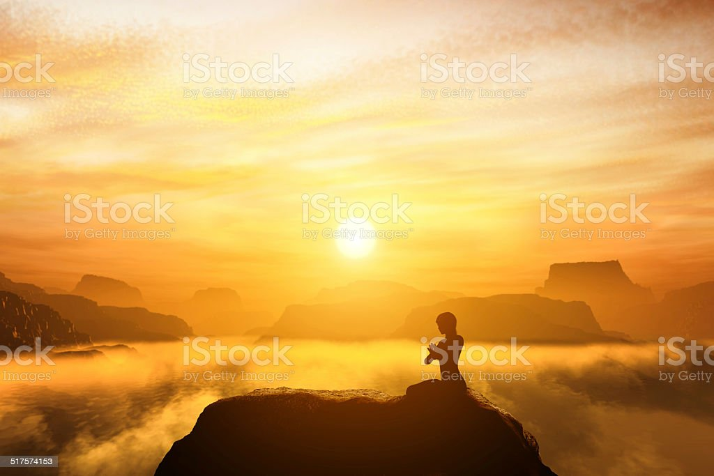 Woman meditating in sitting yoga position stock photo
