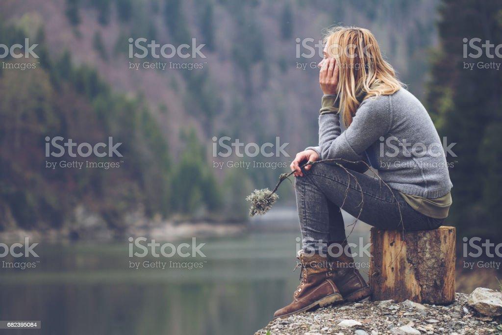 woman meditating on a lake shore royalty-free stock photo