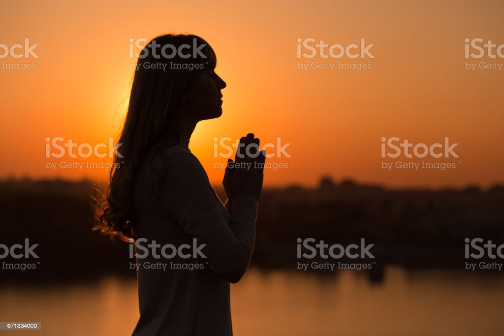 Woman meditating outdoor stock photo