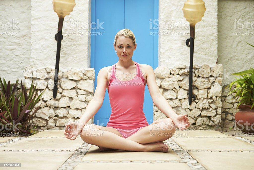 Woman Meditating Outdoors At Health Spa royalty-free stock photo