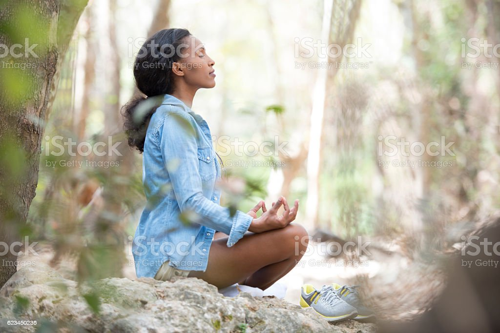 Woman meditating outdoors. stock photo