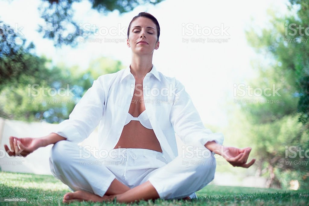 Woman meditating outdoors royalty-free stock photo