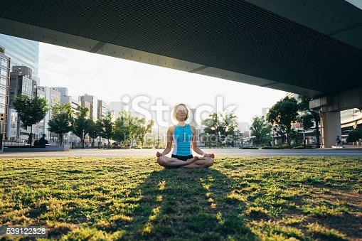 Woman Meditating Under The Bridge At Sunset