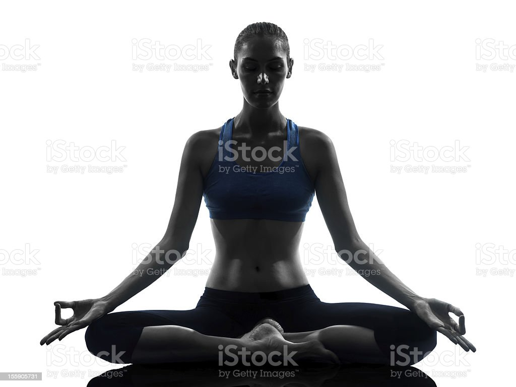 Woman meditating while doing yoga stock photo