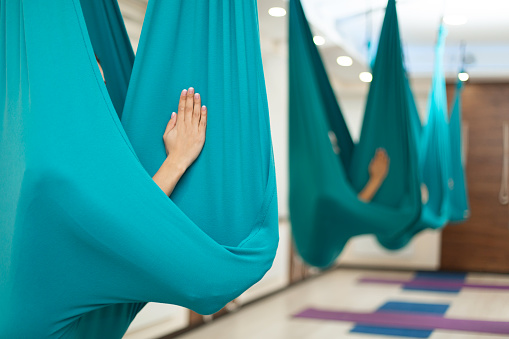Woman Meditation In Hammock Fly Yoga Stretching Exercises In Gym Fit And Wellness Lifestyle Stock Photo - Download Image Now