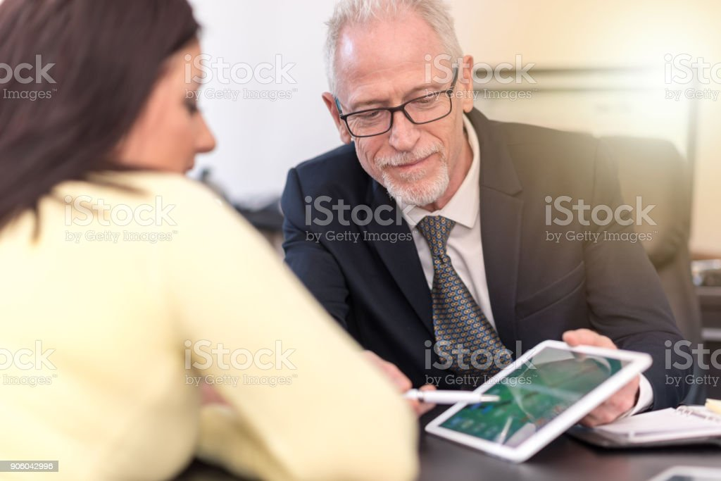 Woman meeting financial adviser in office, light effect stock photo