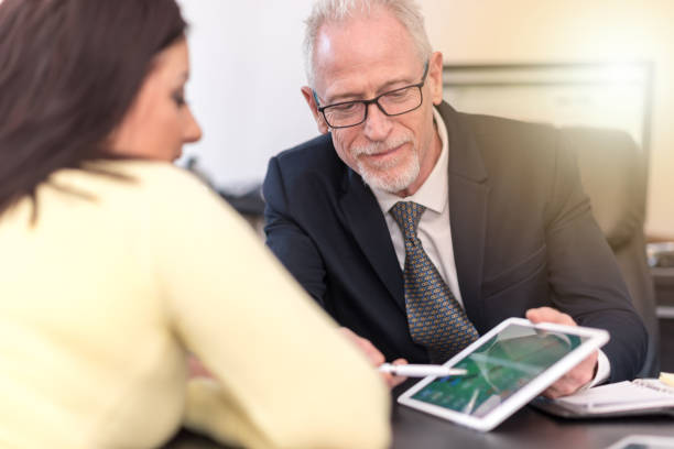 woman meeting financial adviser in office, light effect - bankers stock photos and pictures