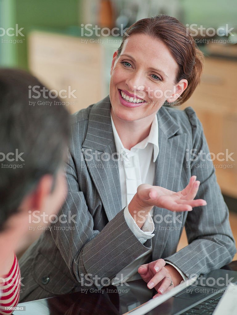 Woman meeting with financial advisor in dining room royalty-free stock photo