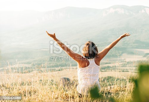 Woman meets sunrise in mountain