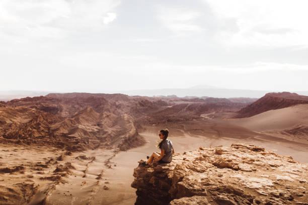 Woman meets sunset at beautiful canyon in Atacama desert stock photo