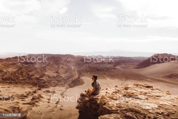 Photo of Woman meets sunset at beautiful canyon in Atacama desert
