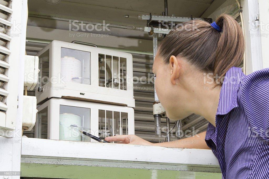 Woman meteorologist reads meteodata stock photo