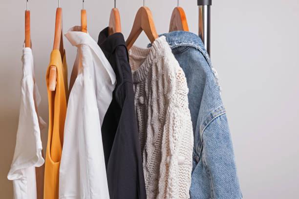 Woman minimalist wardrobe in white and denim stock photo