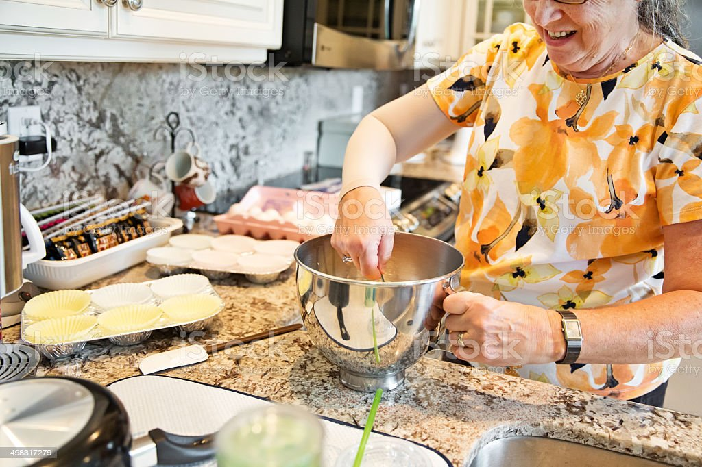 Woman mixing batter for muffins royalty-free stock photo