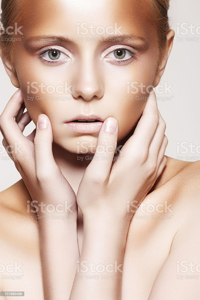 Woman model with fashion bronzer plastic make-up royalty-free stock photo