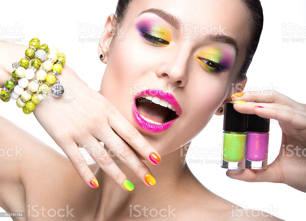 Woman Models Vibrant Colors Of Nail Polish And Eye Shadow Royalty Free Stock Photo