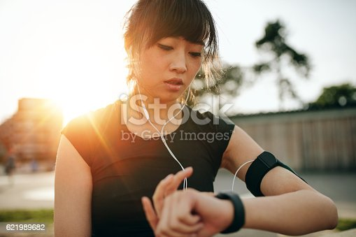 istock Woman monitoring her progress on smartwatch 621989682