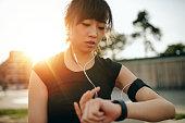 istock Woman monitoring her progress on smartwatch 621989682